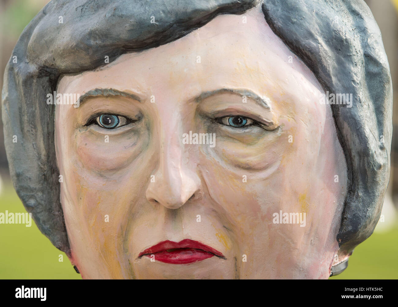 A protestor from campaign group Avaaz wearing a Theresay May giant head demonstrate outside the Houses of Parliament, Stock Photo