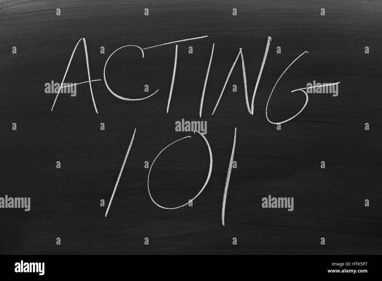 The words 'Acting 101' on a blackboard in chalk - Stock Image