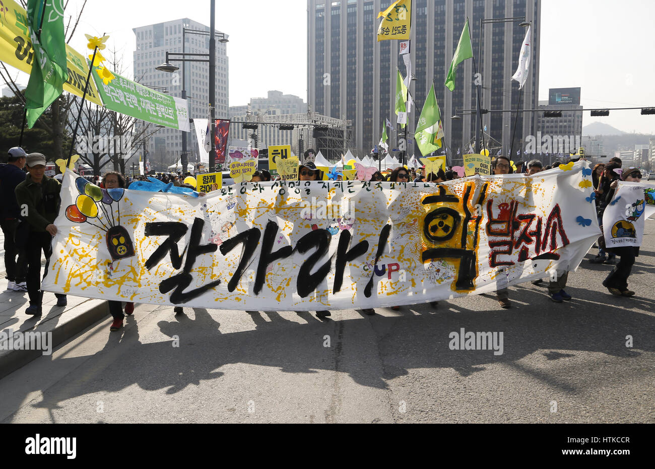 The sixth anniversary of the 2011 Fukushima nuclear disaster, Mar 11, 2017 : People march during a memorial rally - Stock Image