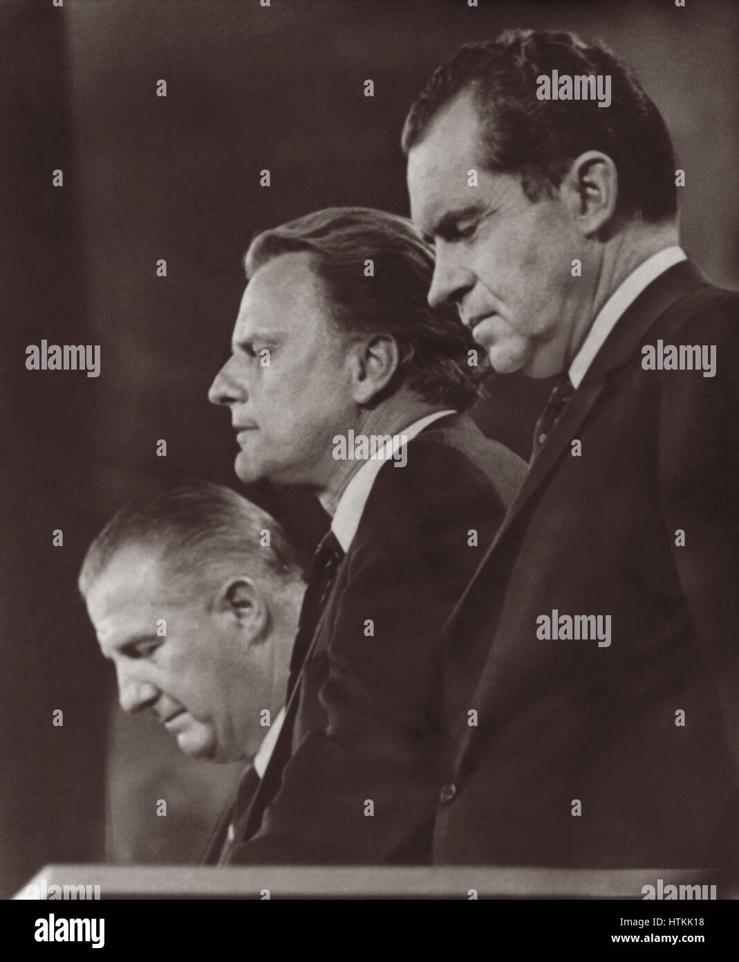 Billy Graham giving closing benediction at the 1968 Republican National Convention flanked by presidential nominee - Stock Image