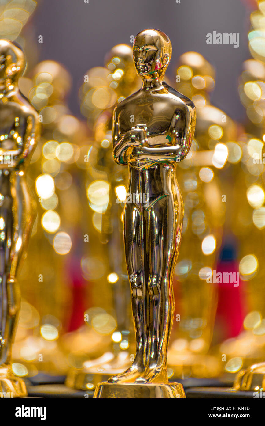 A Group of Shiny Gold Trophies - Stock Image