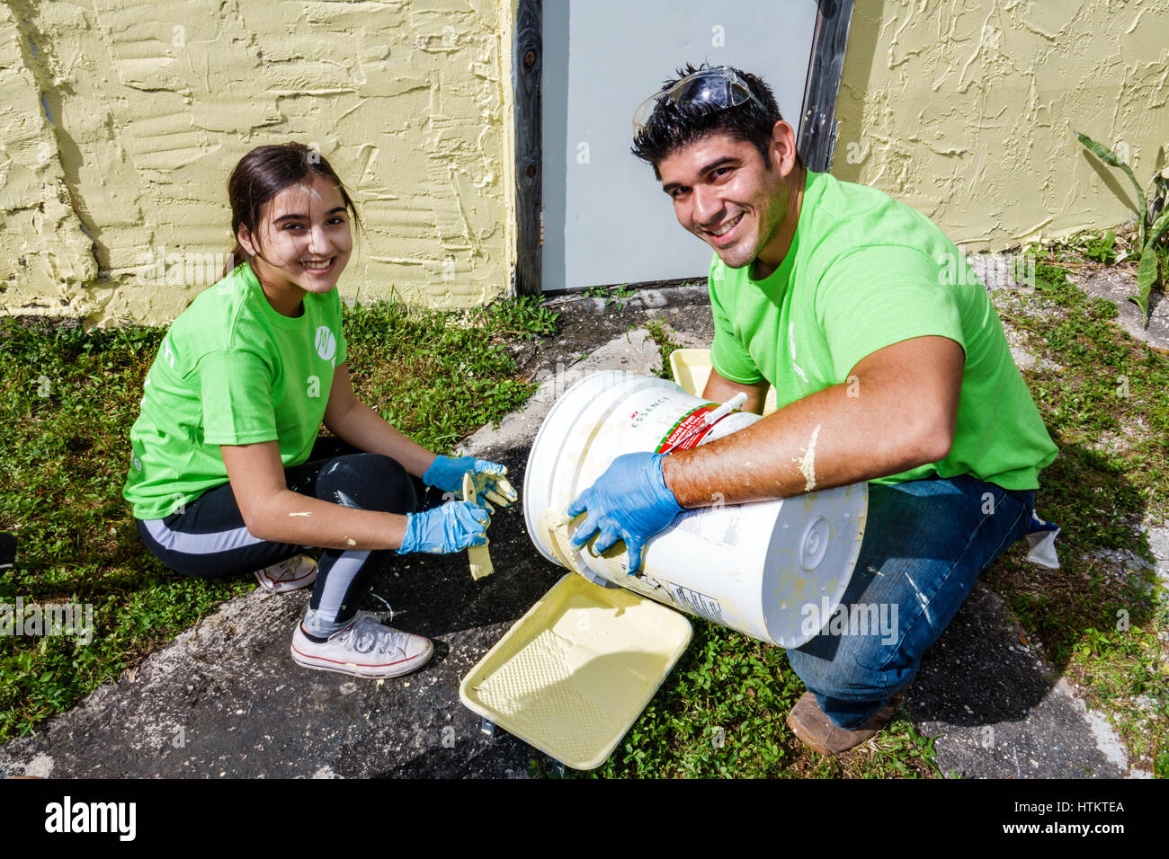 Miami Florida Allapattah Martin Luther King Jr. Day of Service MLK senior home repair Hispanic man girl teen father - Stock Image