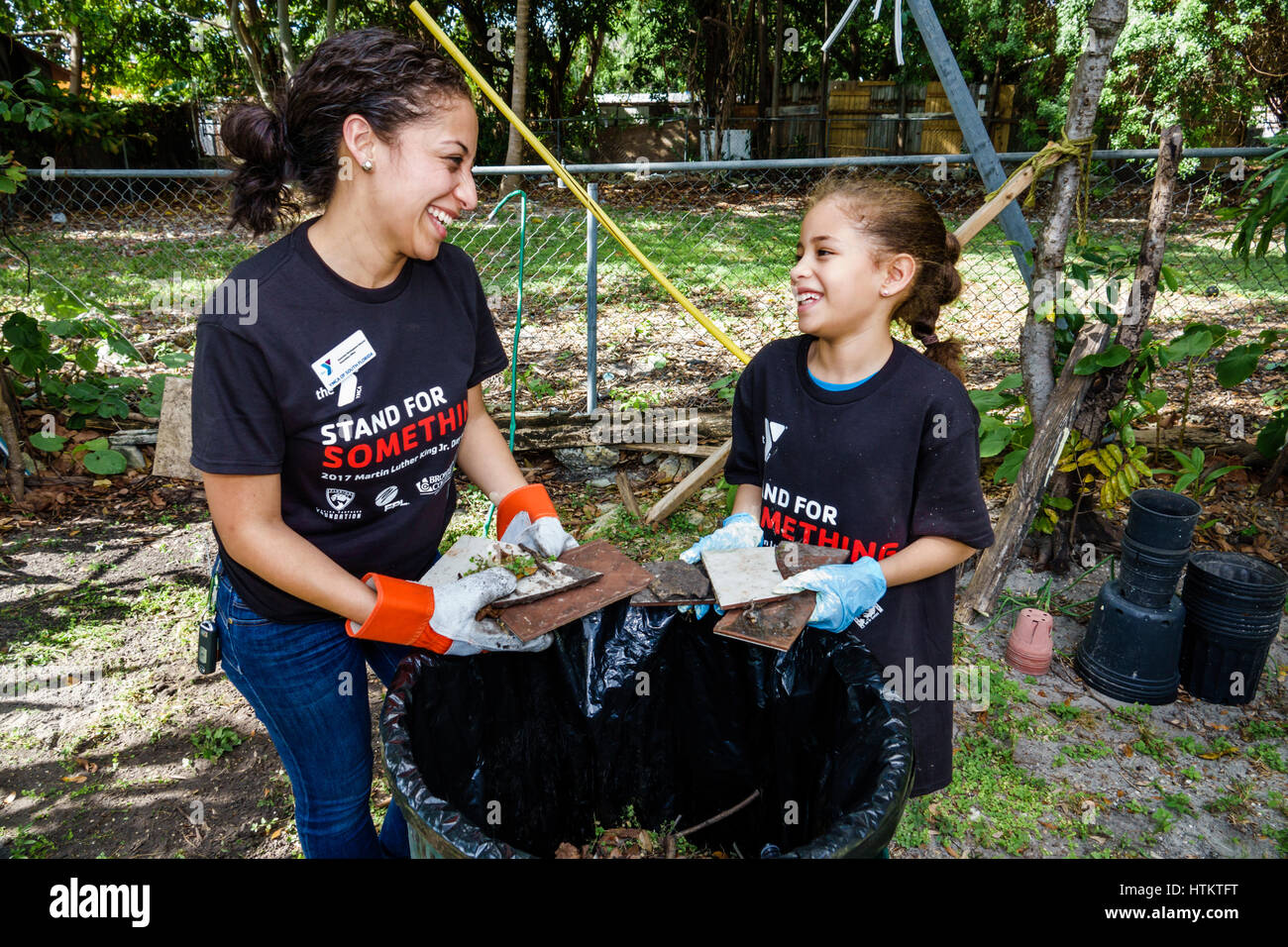 Miami Florida Allapattah Martin Luther King Jr. Day of Service MLK senior home repair woman girl mother daughter - Stock Image