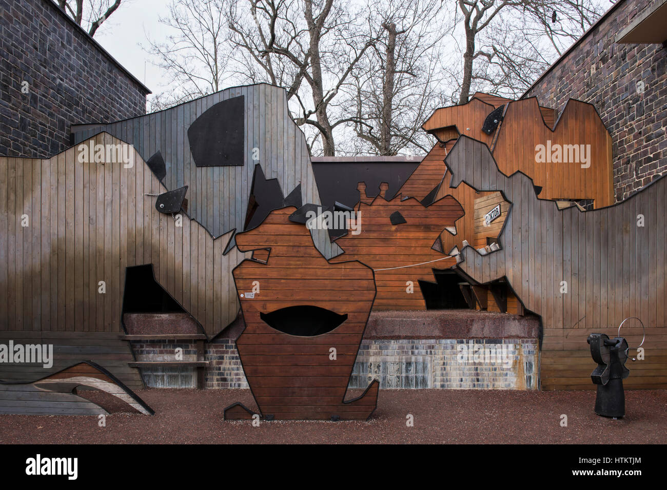 Creative outdoor playground made of artistically designed wood in the form of animals. Leipzig Zoological Garden, Stock Photo
