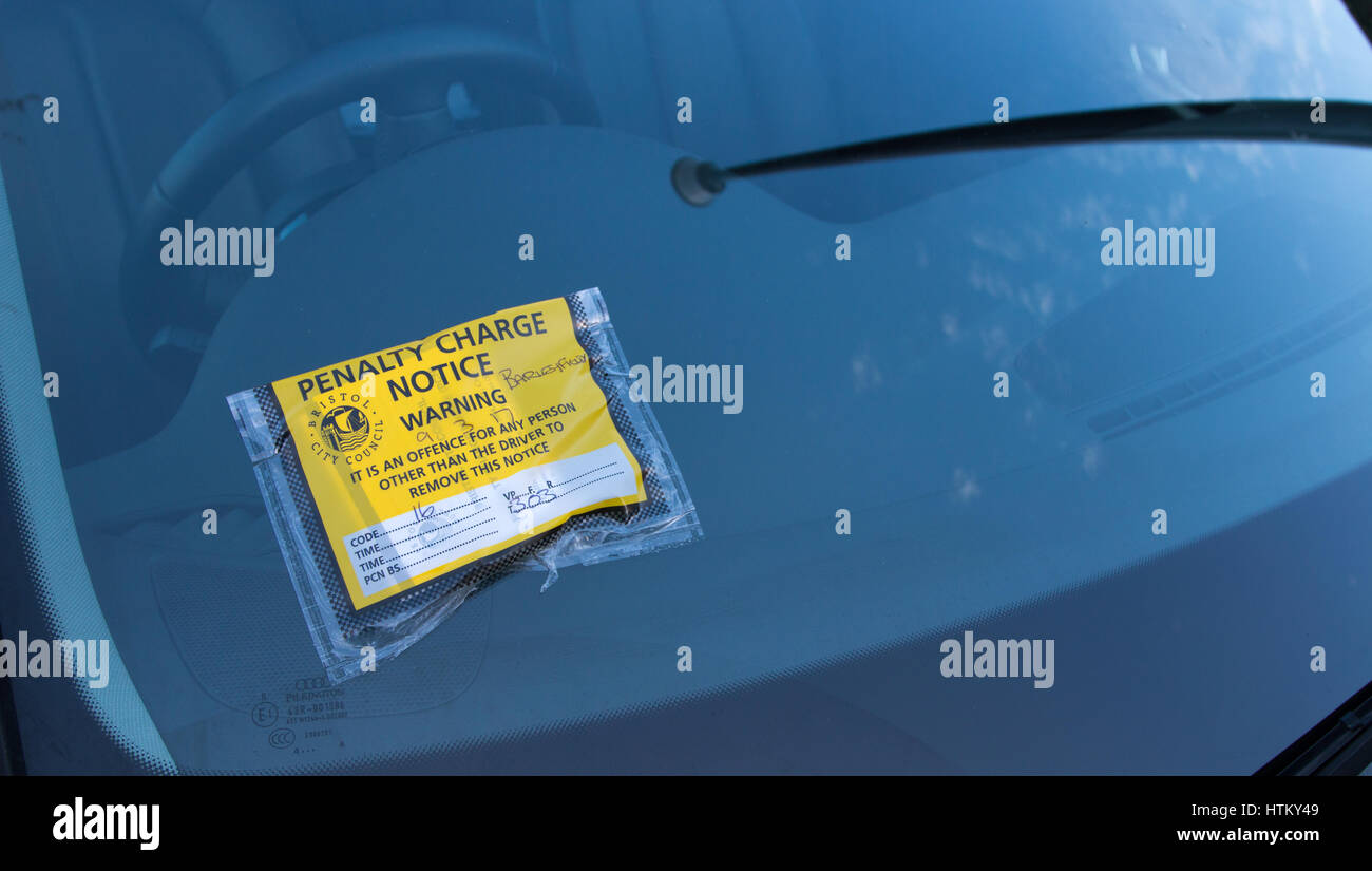 BRISTOL: A Penalty Charge Notice affixed to the windscreen of a car parked in a resident's parking scheme area. - Stock Image