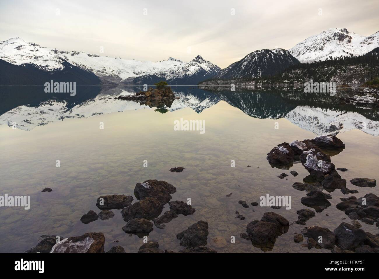 View across Garibaldi Lake in Coast Mountains of British Columbia, Canada from end of hiking trail at west end of Stock Photo