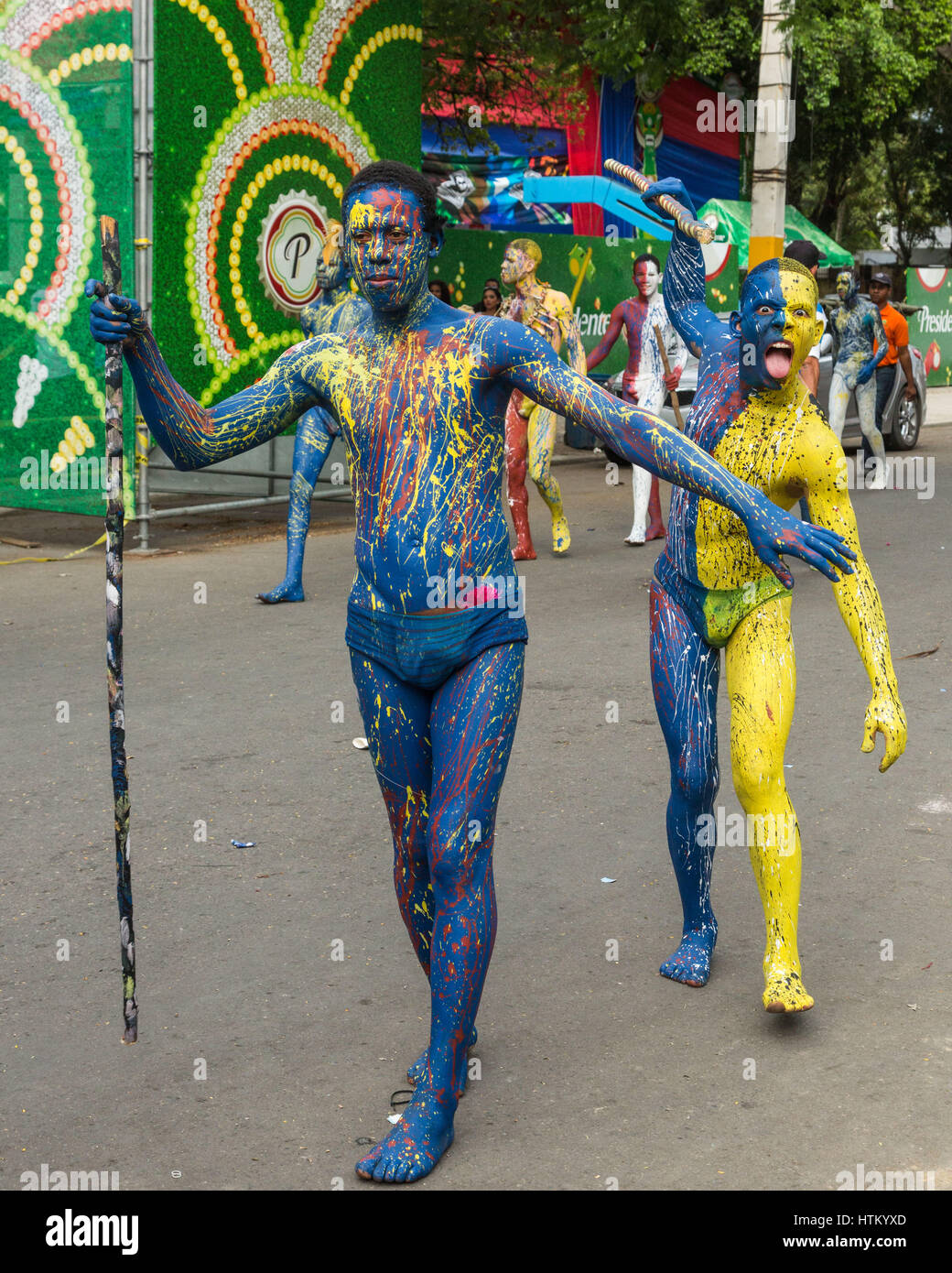 Young men in body paint as a tribal warrior in the La Vega Carnival parade.The first documented Carnival celebration - Stock Image