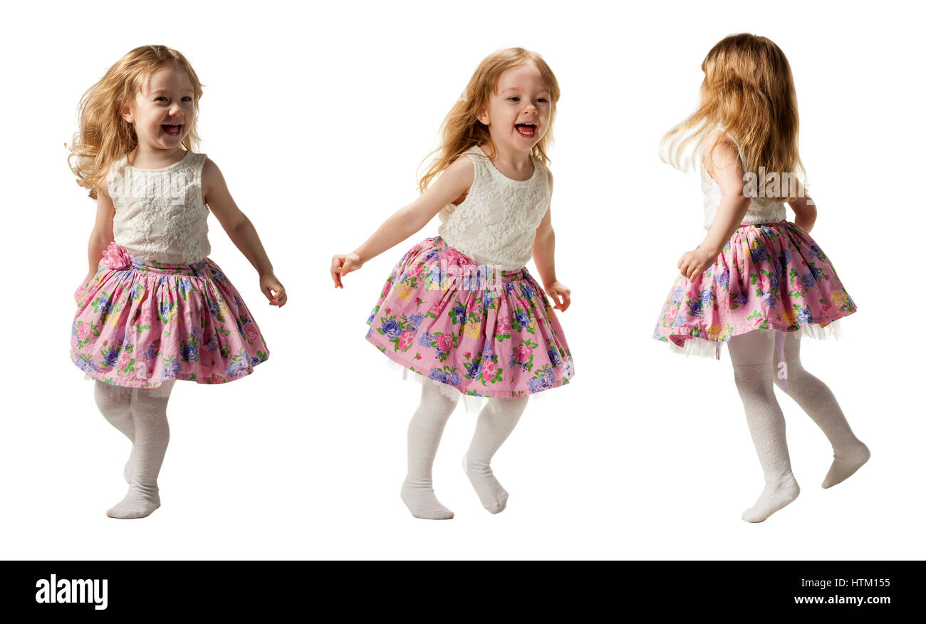 Cute little girl jumping with joy isolated on white background - Stock Image