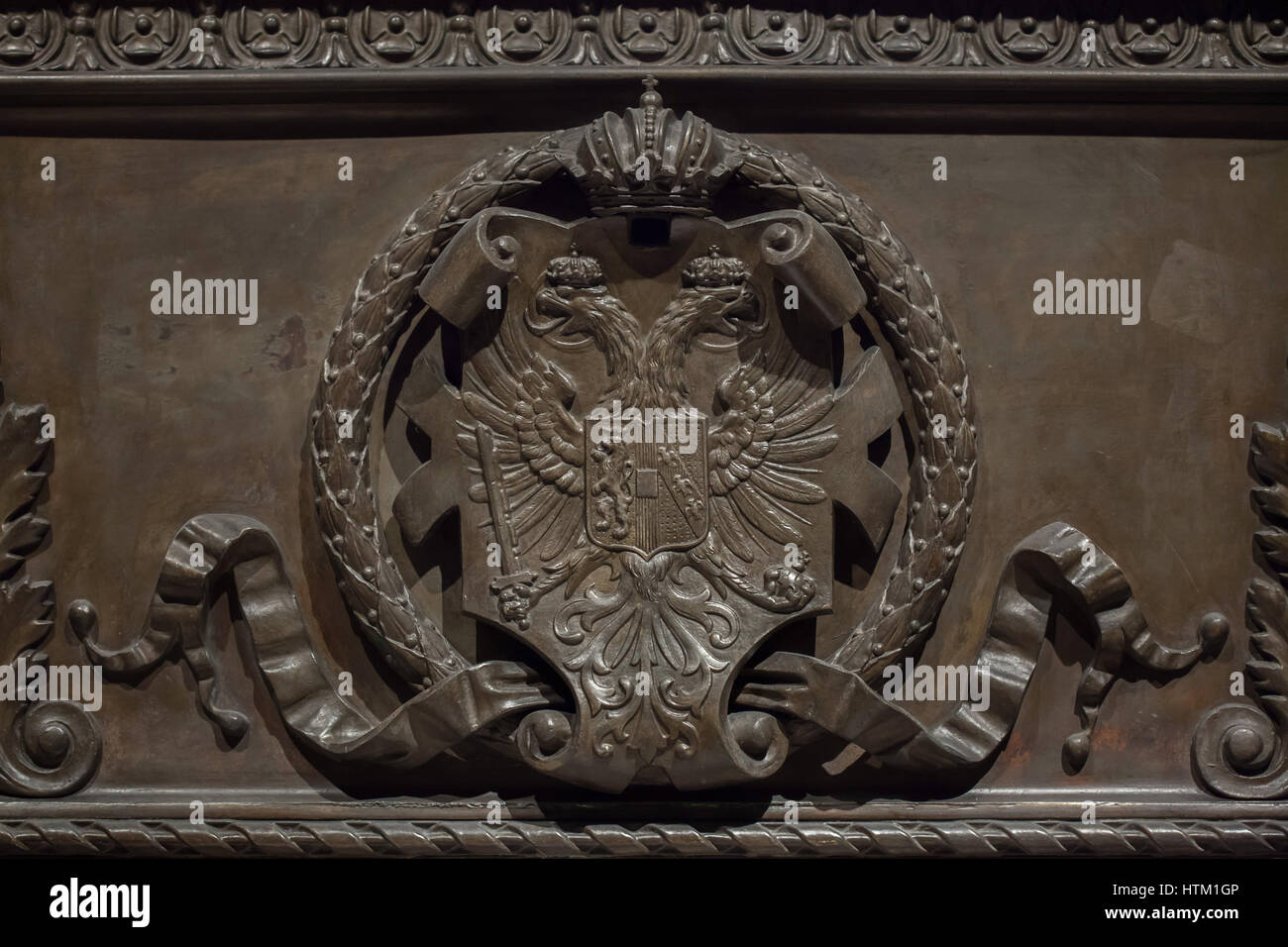 Coat of arms of Austria depicted on the sarcophagus of the Emperor Ferdinand I of Austria (1793 - 1875) in the Kaisergruft - Stock Image