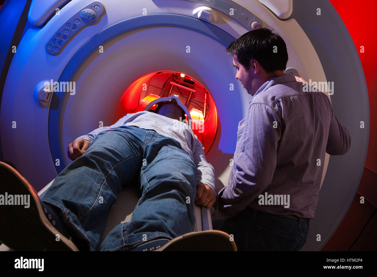 Patient undergoing MRI scan at Cardiff University School of Psychology, Cardiff, Wales, United Kingdom - Stock Image