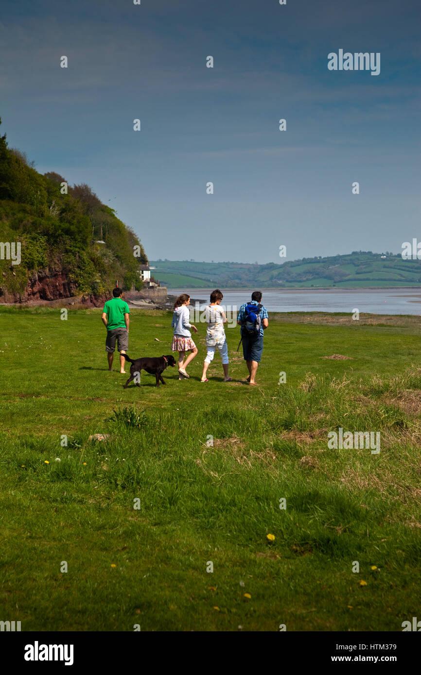 Family walking dog in Carmarthenshire, Wales, UK - Stock Image