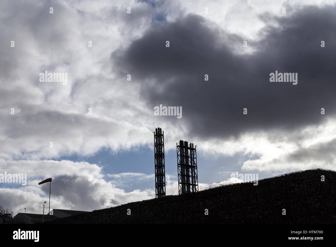 industrial pipes with leaden skies - Stock Image