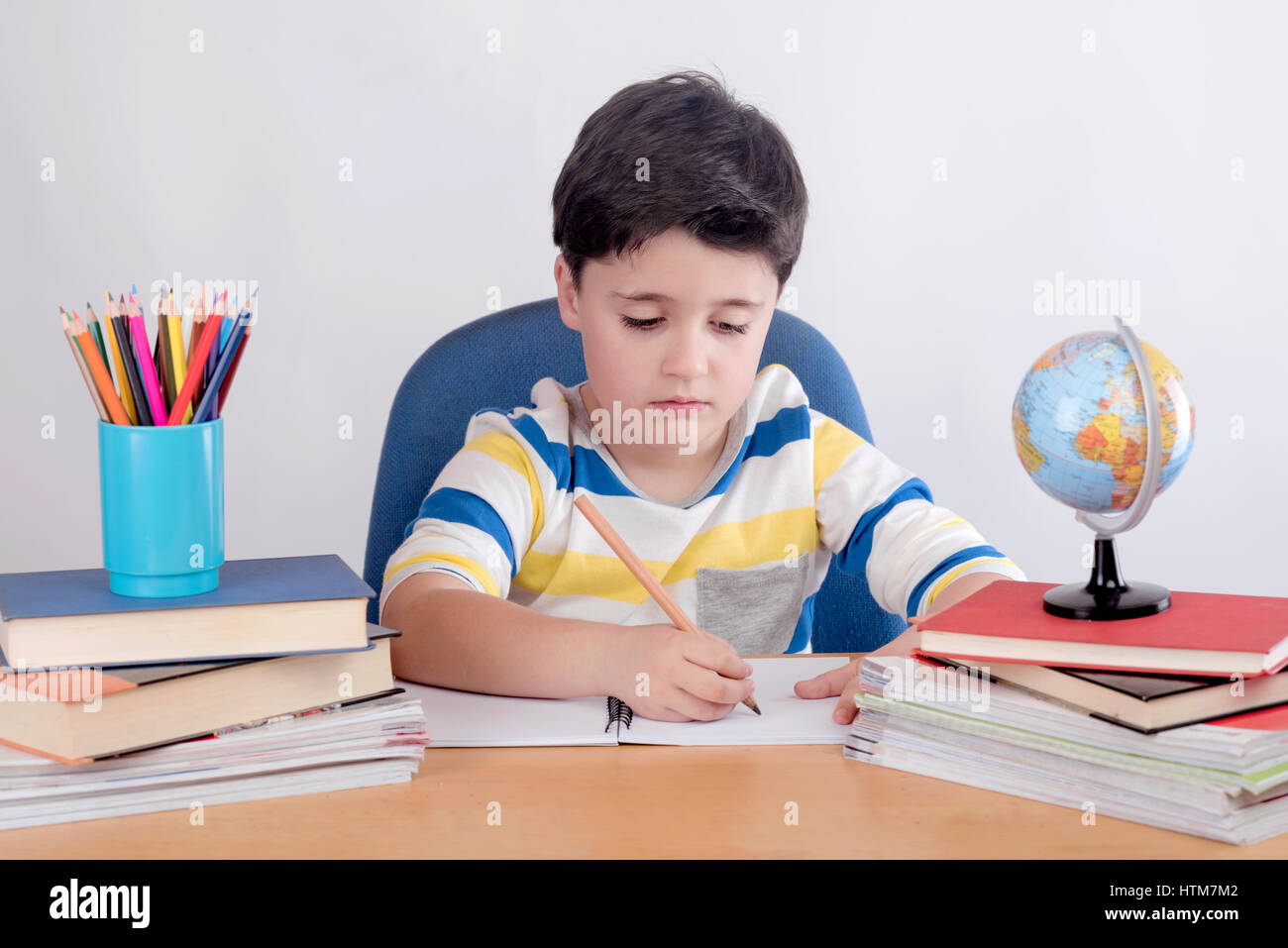 Concentrated child studying Stock Photo