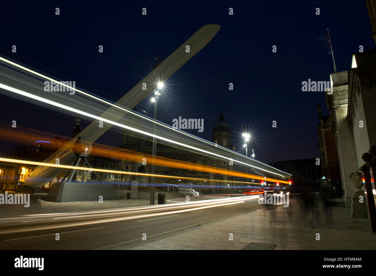 Light trails from buses passing under the Wind Turbine Blade on display as part of the UK City of Culture 2017 in - Stock Image