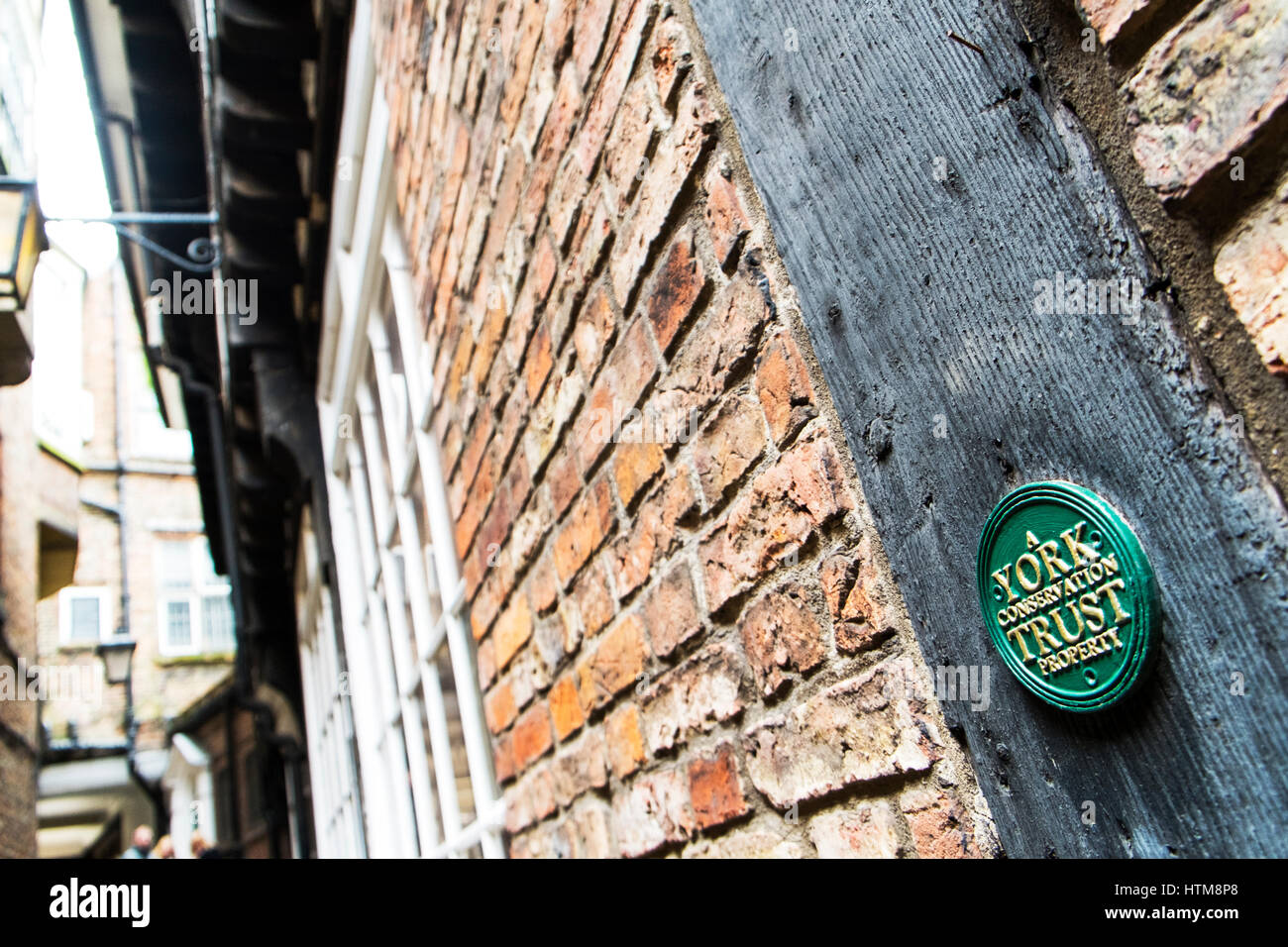 A York conservation trust property plaque sign on wall old properties in York status UK England Old building York - Stock Image
