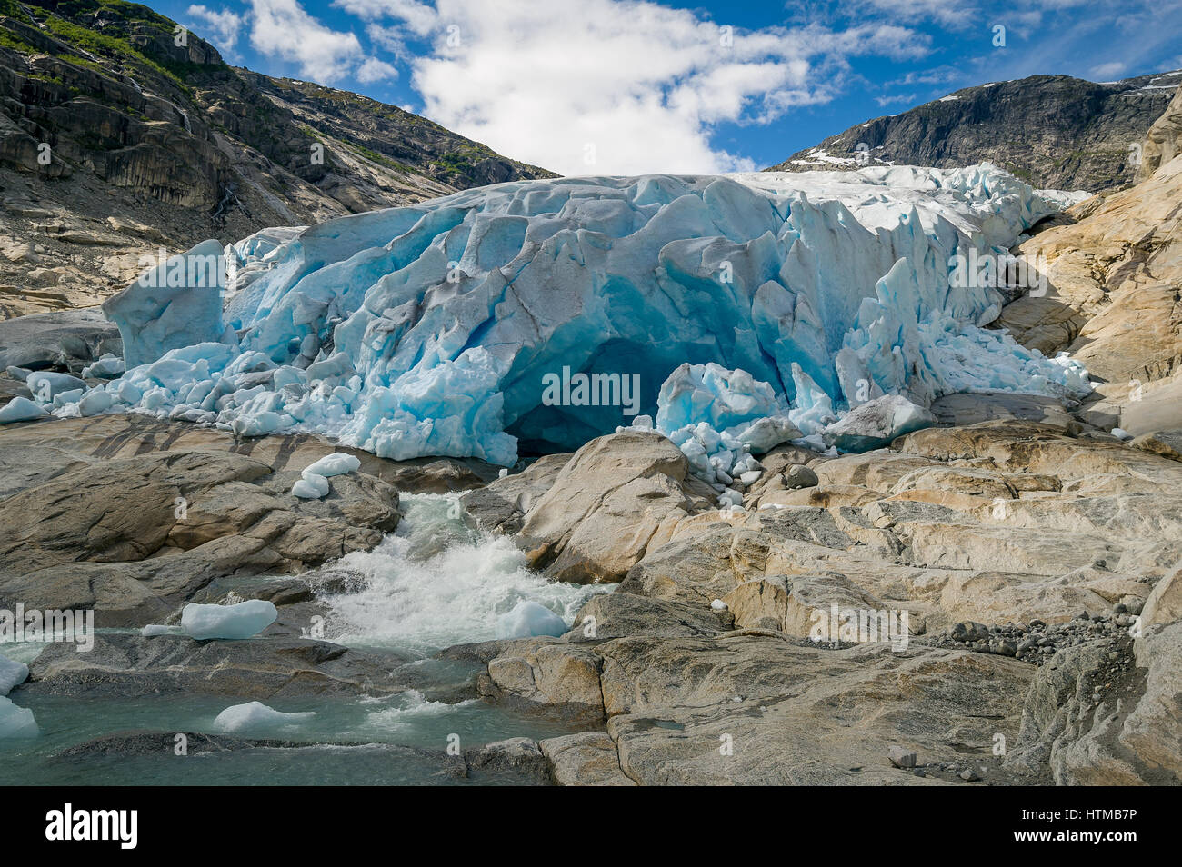 Nigardsbreen Glacier ice cave and river - Stock Image