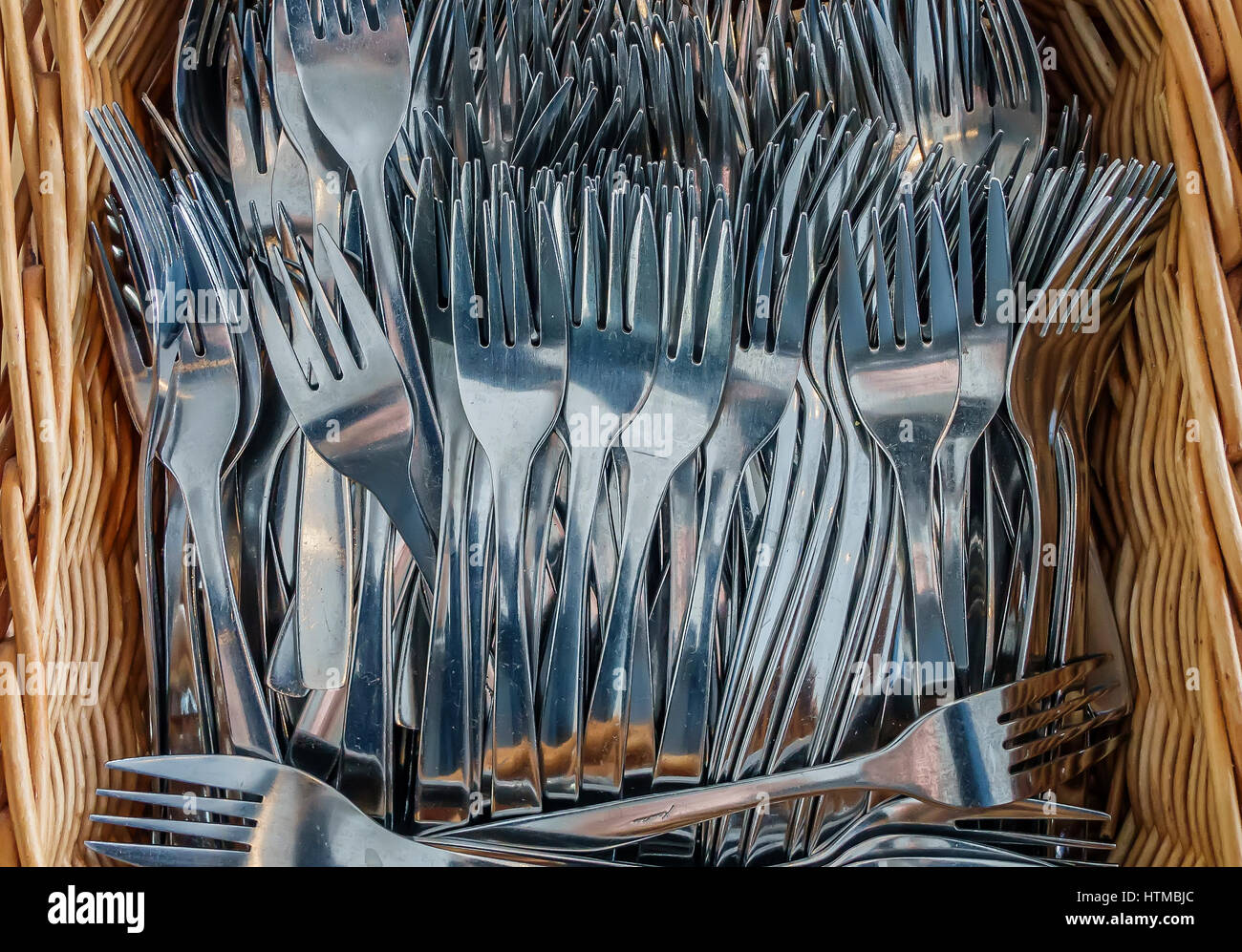 Forks in a basket - Stock Image