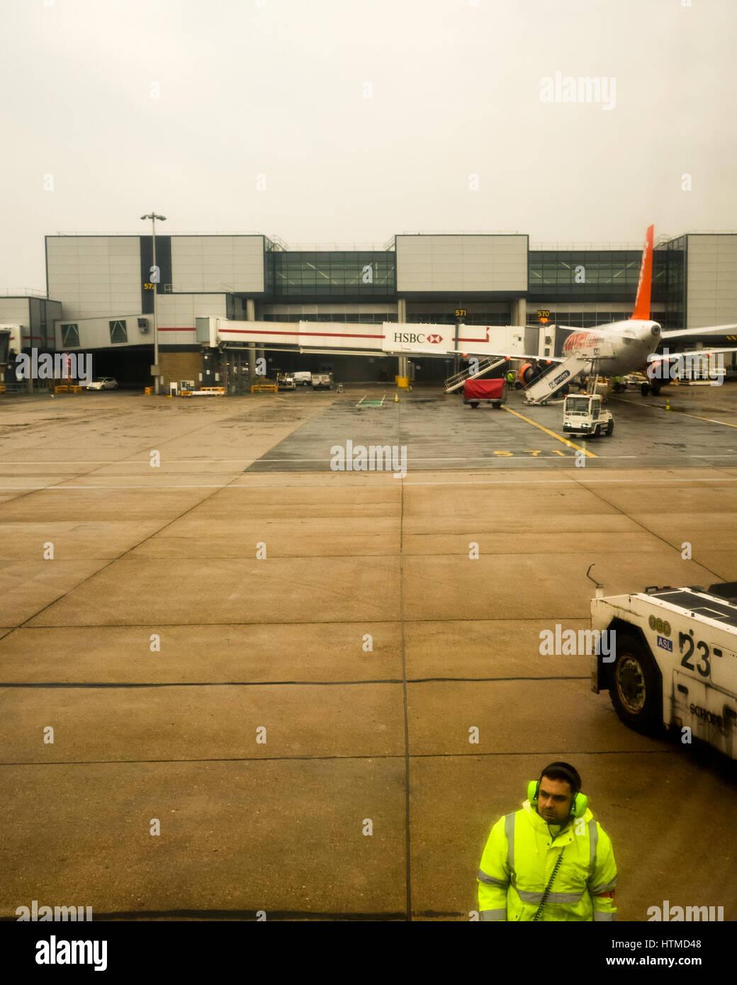 London Gatwick. England UK. EasyJet aeroplanes on London Gatwick airport runway preparing for take off.  A member Stock Photo