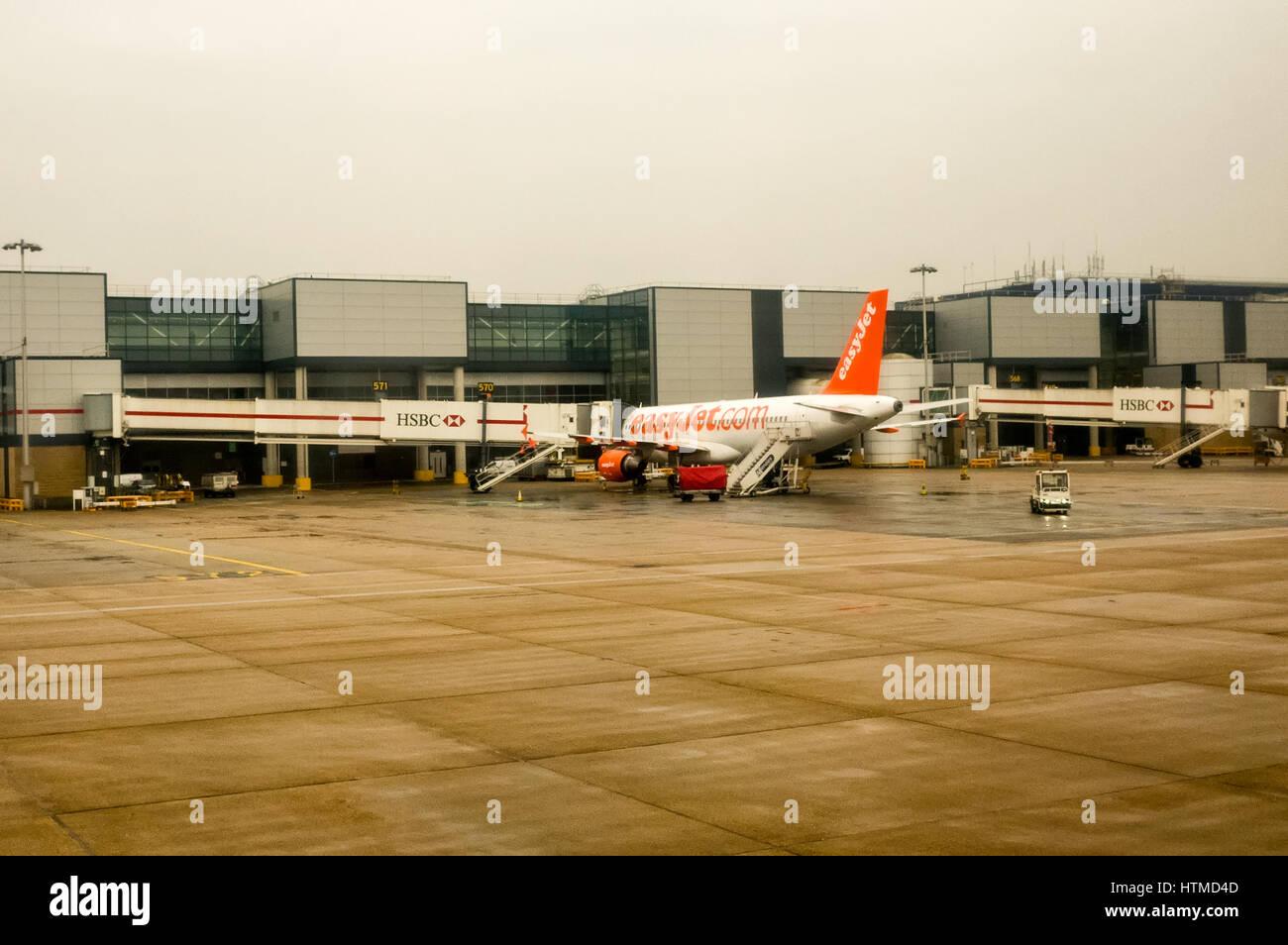 London Gatwick. England UK. EasyJet planes on London Gatwick airport runway preparing for take off. - Stock Image