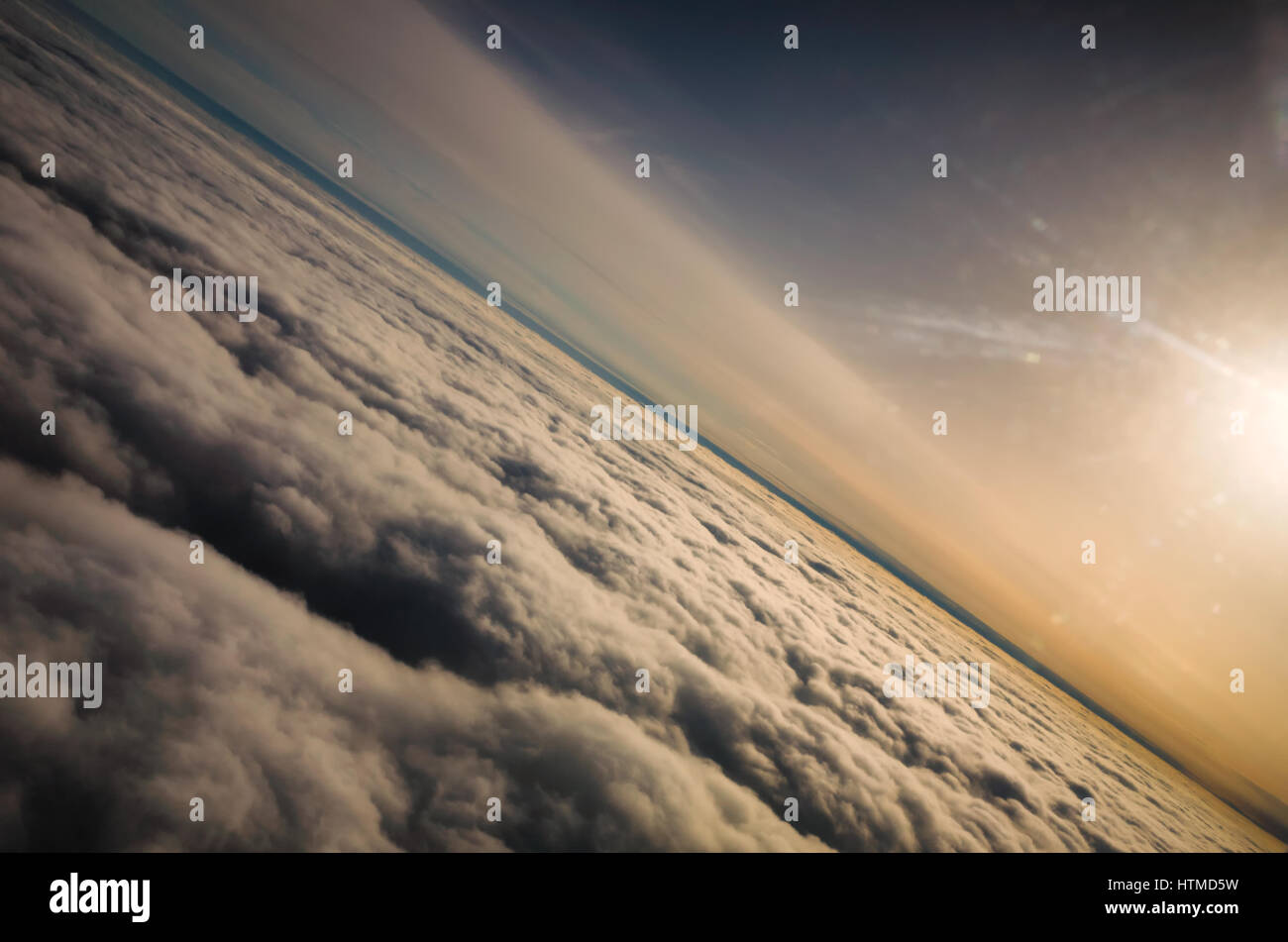 View of cloud formation and colourful skies flying above the clouds. - Stock Image