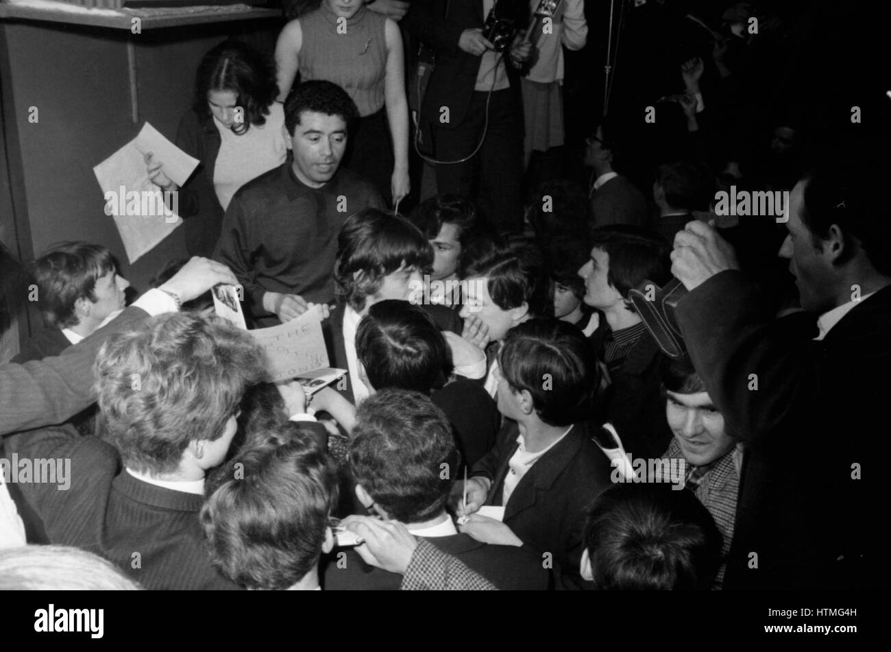 British singer of the Rolling Stones Mick Jagger signing autographs in the backstage of the Golf-Drouot in Paris - Stock Image