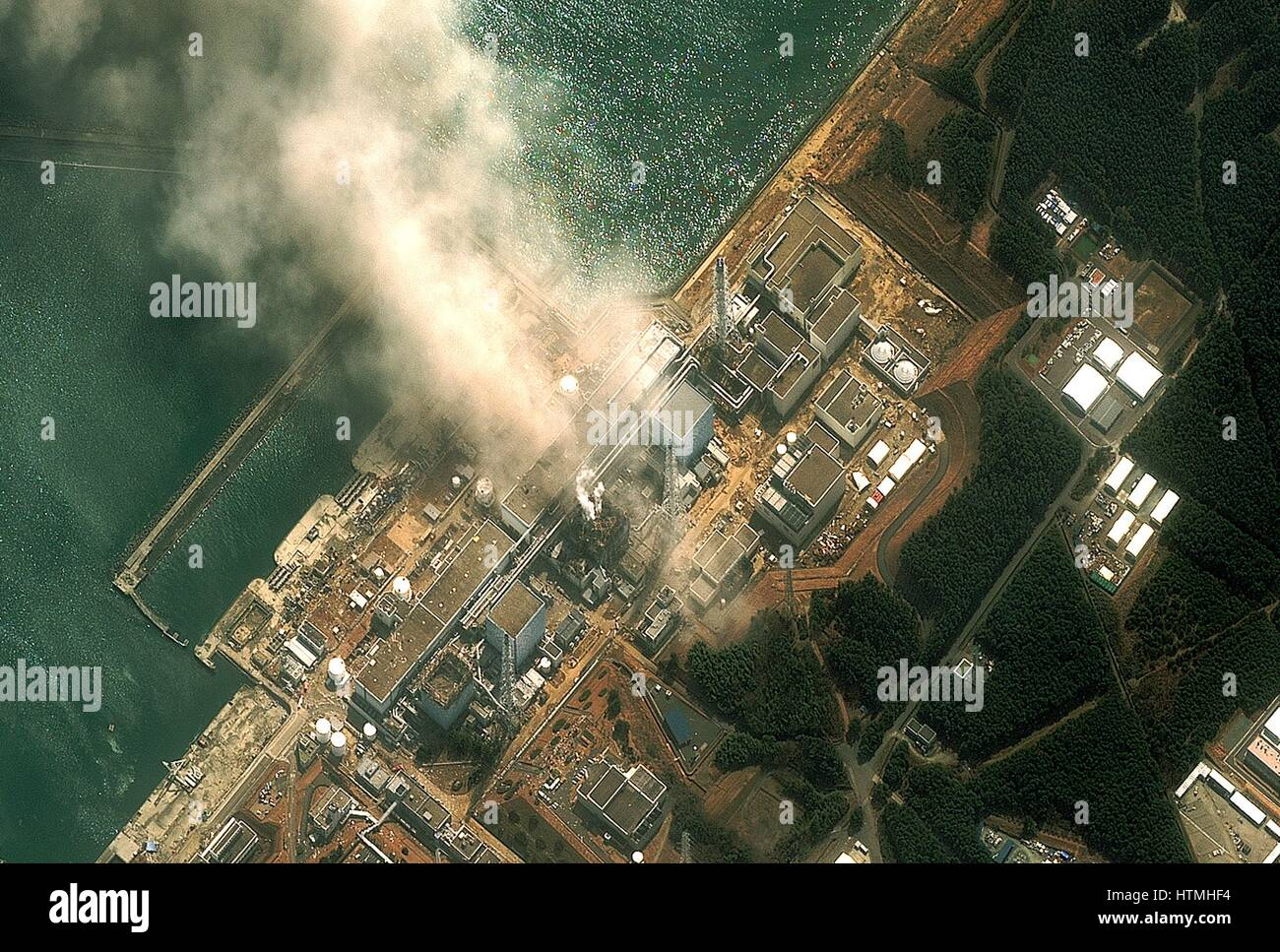 Fukushima Daiichi reactor in North eastern Japan 2011 Satellite view of earthquake damage to the reactors march14th - Stock Image