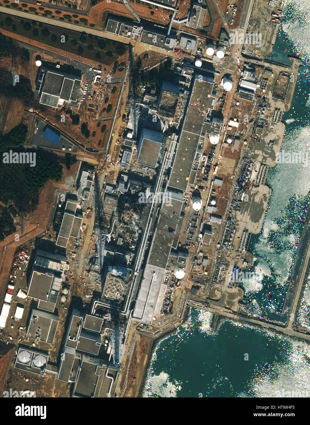 Fukushima Daiichi reactor in North eastern Japan 2011 Satellite view of earthquake damage to the reactors march17th - Stock Image