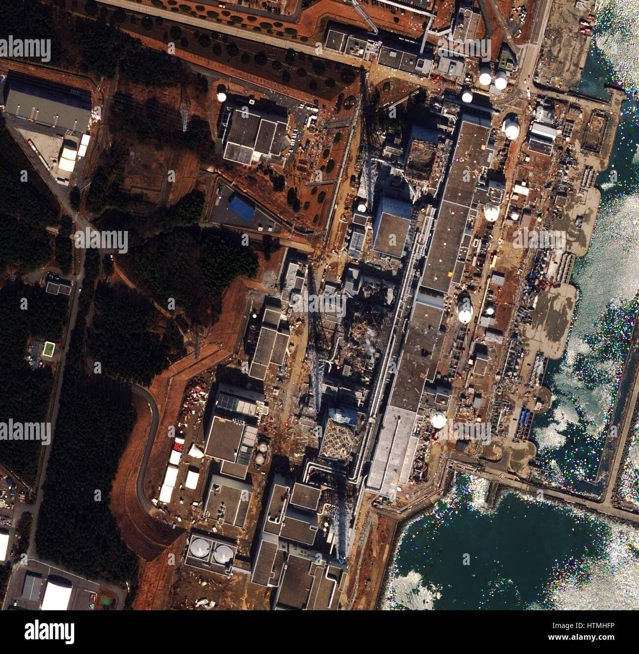 Fukushima Daiichi reactor in North eastern Japan 2011 Satellite view of earthquake damage to the reactors march15th - Stock Image