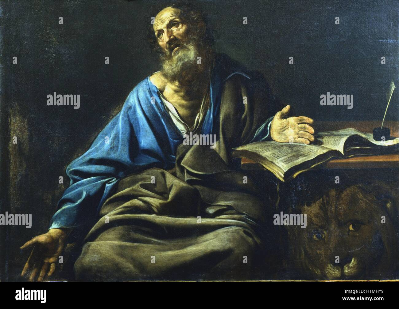 Valentin DE BOULOGNE (1591-1632). St Mark the Evangelist. From under the table St Mark's symbol, the lion, looks - Stock Image
