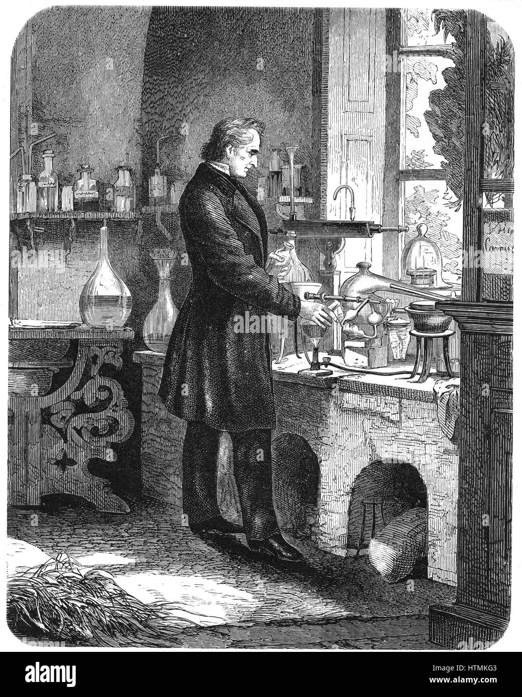 Justus von Liebig (1803-1873) German chemist, at work in his laboratory. Engraving from 'The Popular Educator', - Stock Image