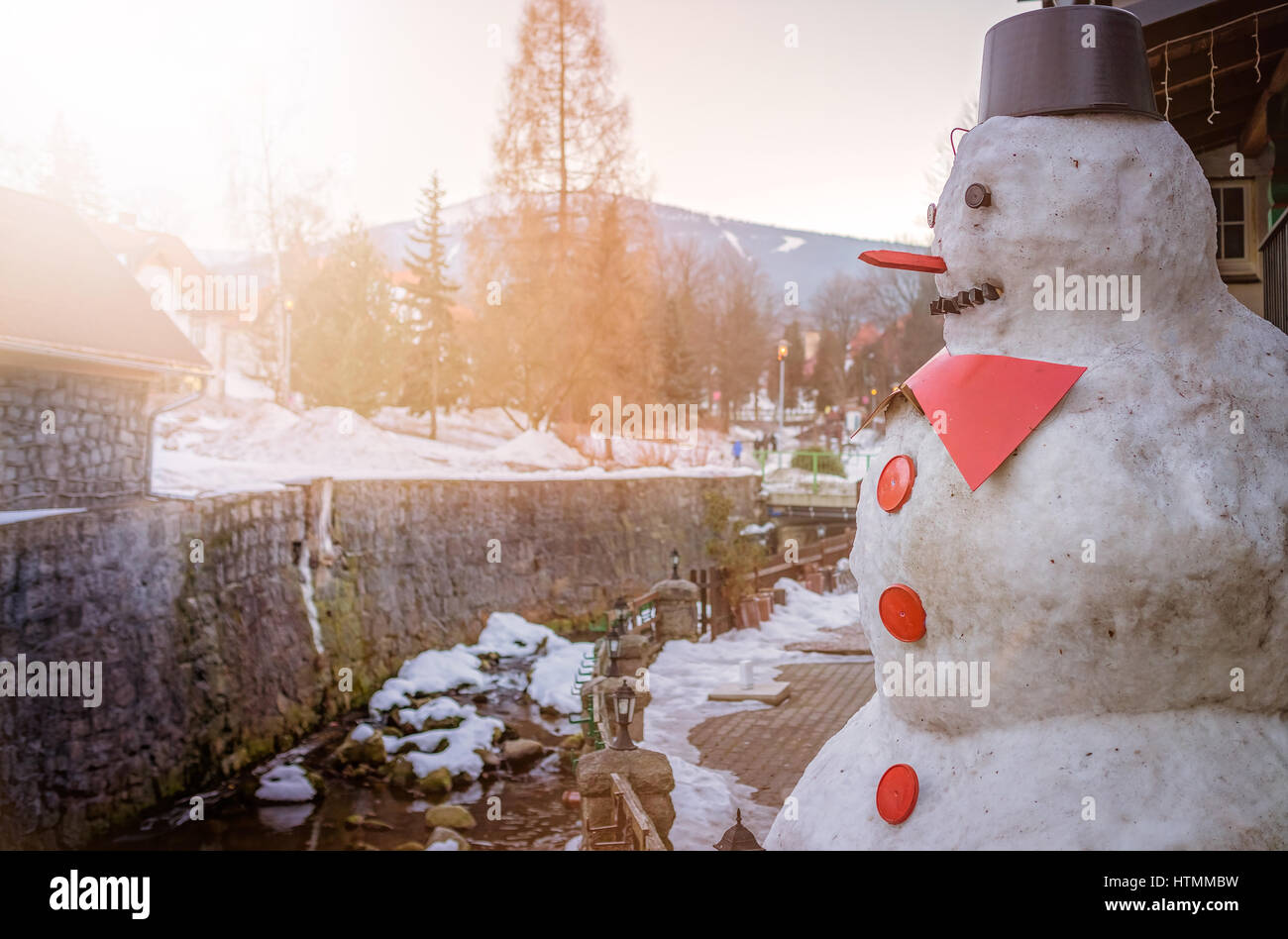 Large big fat snowman with red nose and buttons Stock Photo