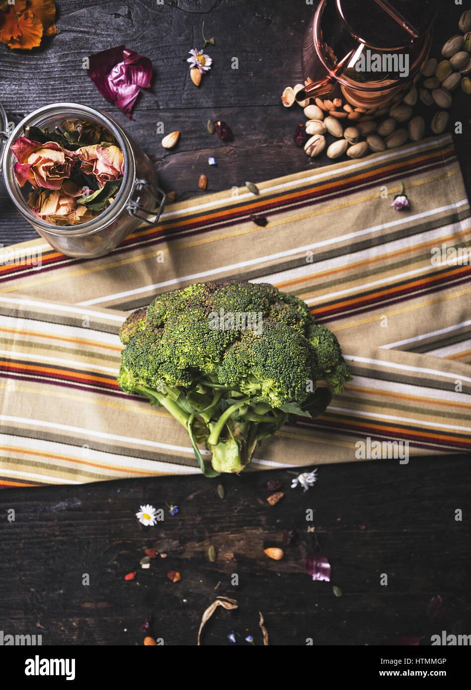 Raw broccoli on dark wooden table Stock Photo