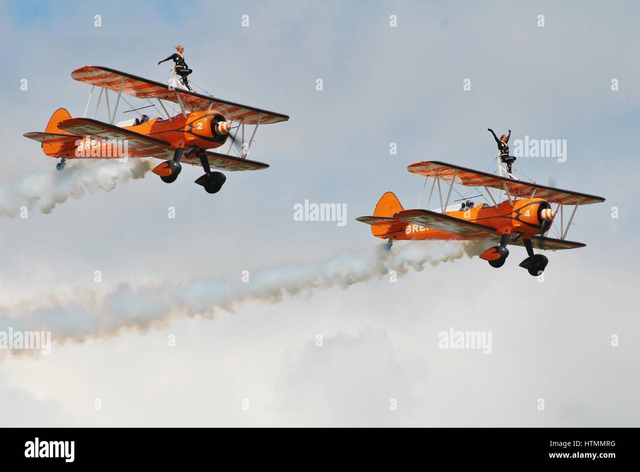 The Breitling Wing Walking team perform at the Dunsfold airshow in surrey, england. The team fly 1940s Boeing Stearman - Stock Image