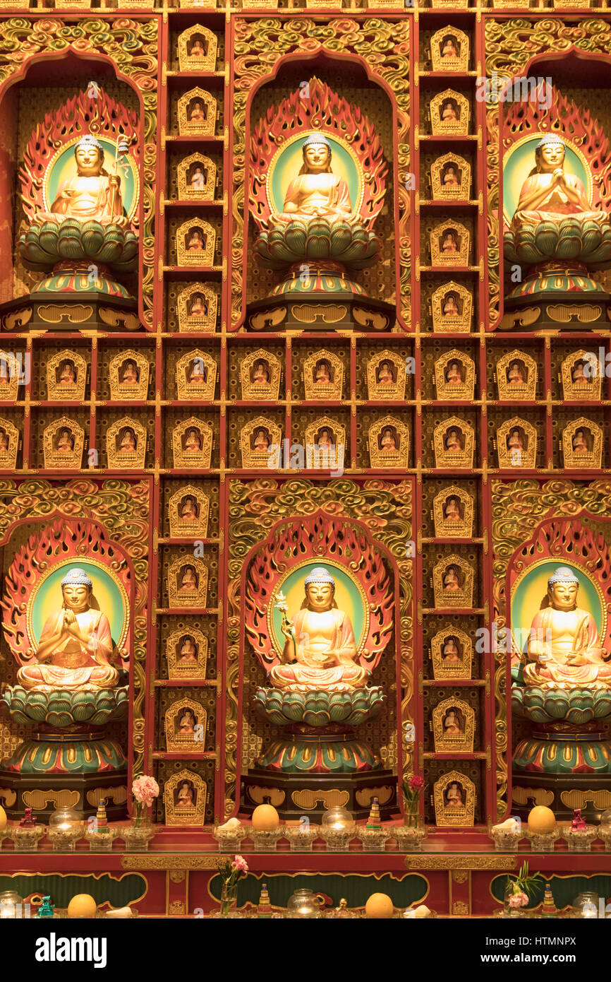 Buddha statues in Buddha Tooth Relic Temple, Chinatown, Singapore - Stock Image