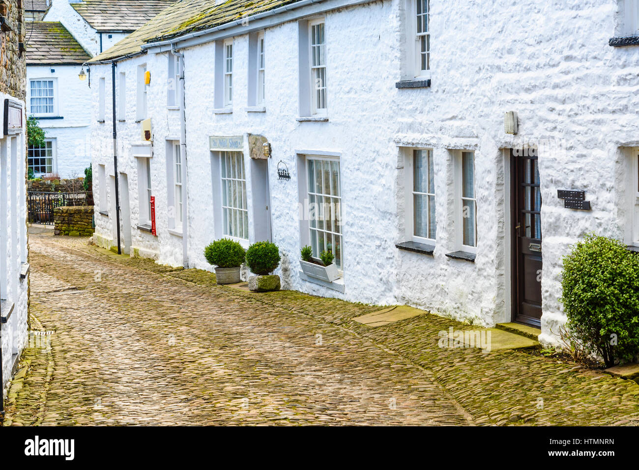 Cobbled street in the village of Dent, Cumbria - Stock Image