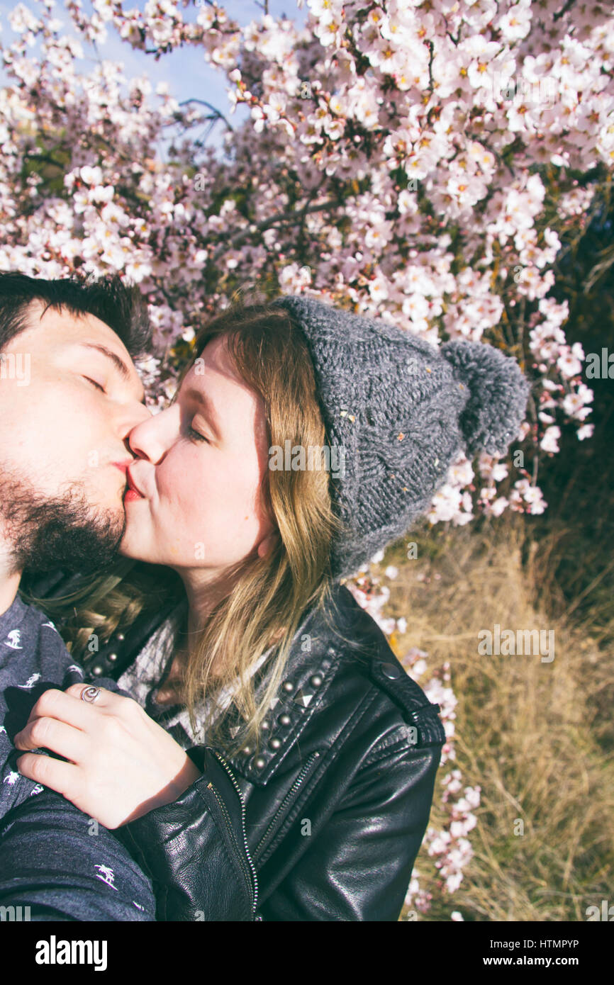 Young hipster couple in love in spring Stock Photo