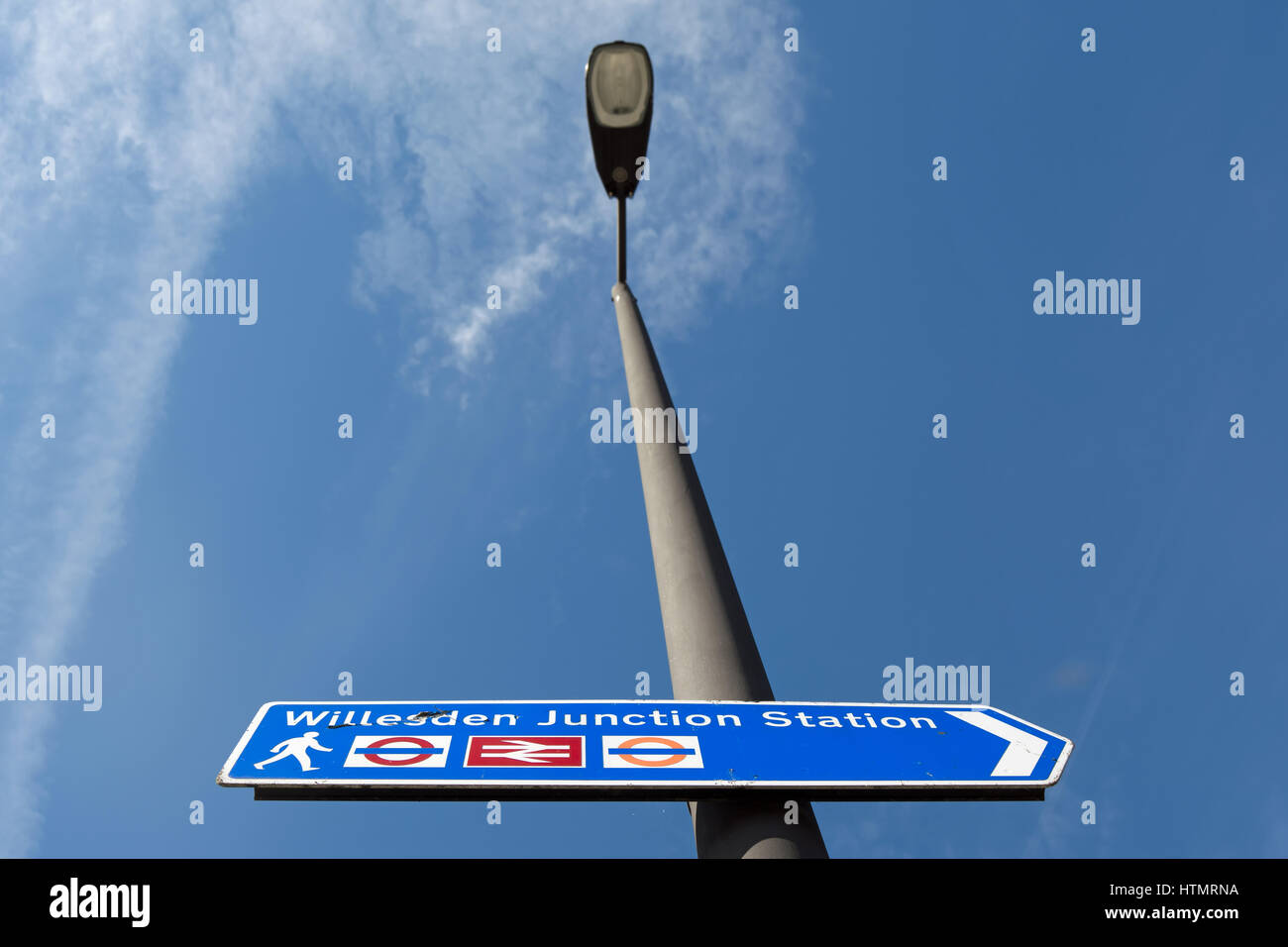 right pointing sign for willesden junction station, west london, england - Stock Image