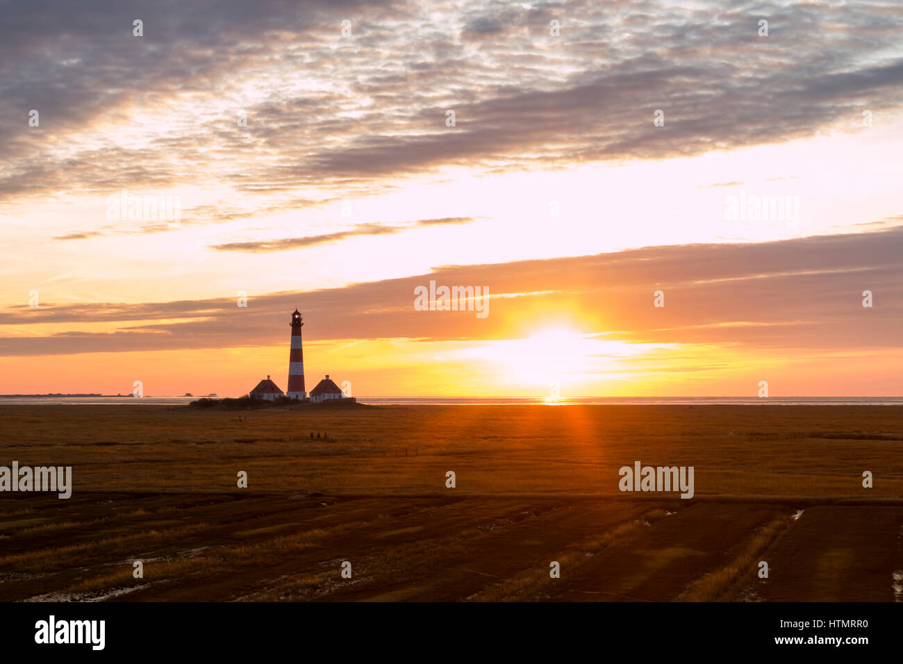 Sunset at the lighthouse Westerheversand, North Frisia, Germany Stock Photo
