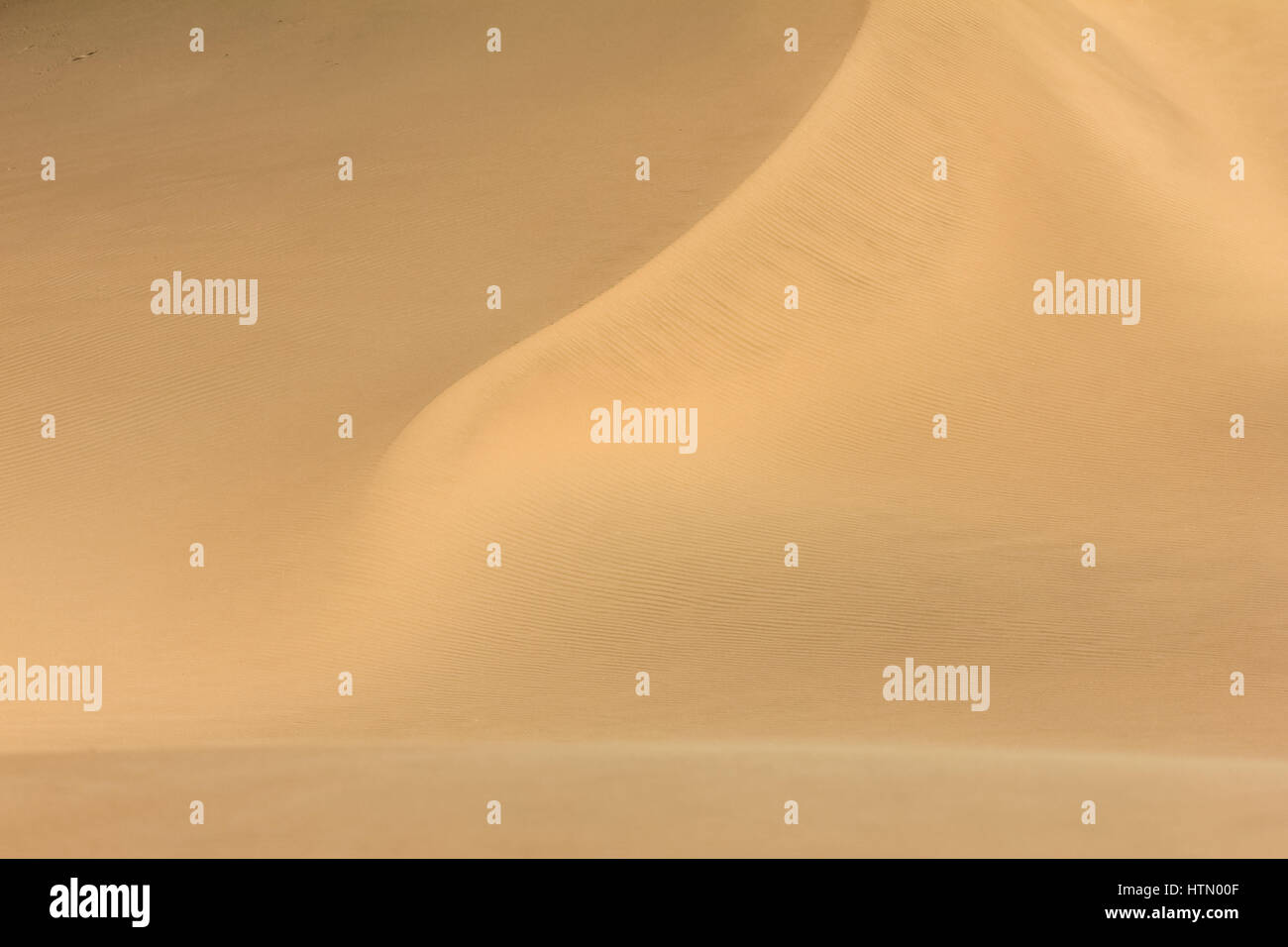 Shifting sand dune contrasts. Desert or beach sand textured background. - Stock Image