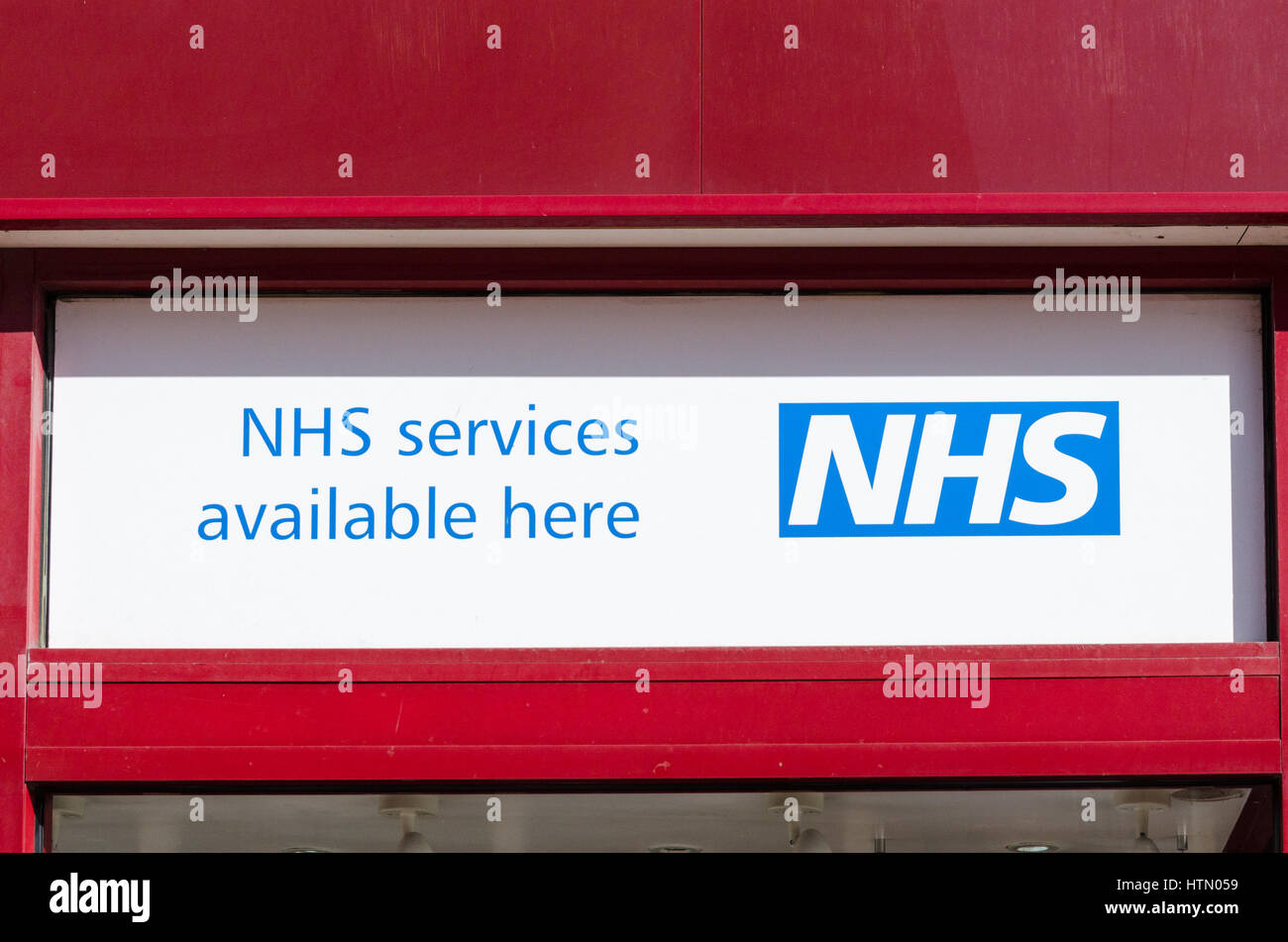 Sign at pharmacy advertising NHS services available - Stock Image