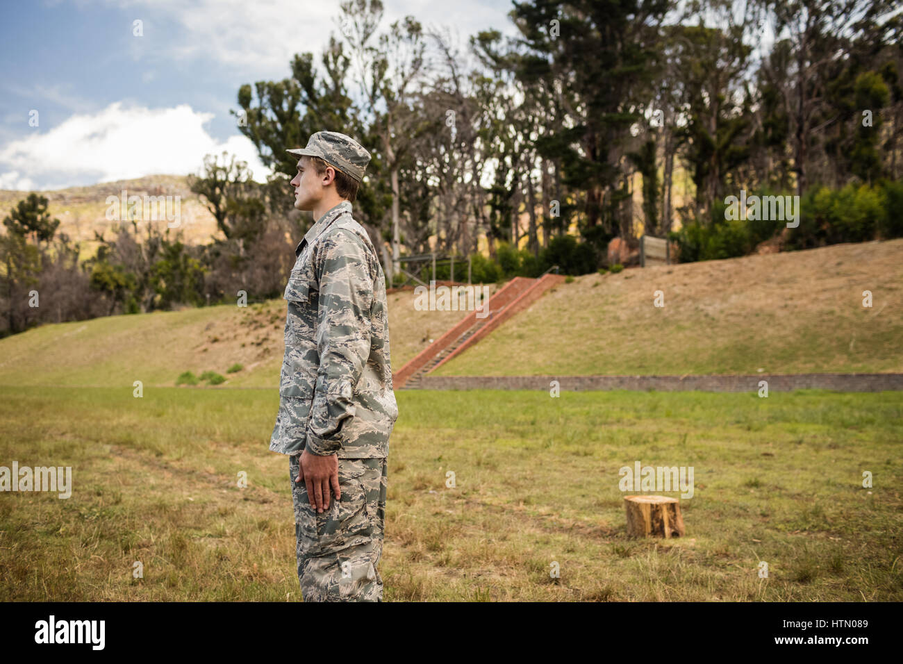 Military soldier standing at attention posture in boot camp - Stock Image