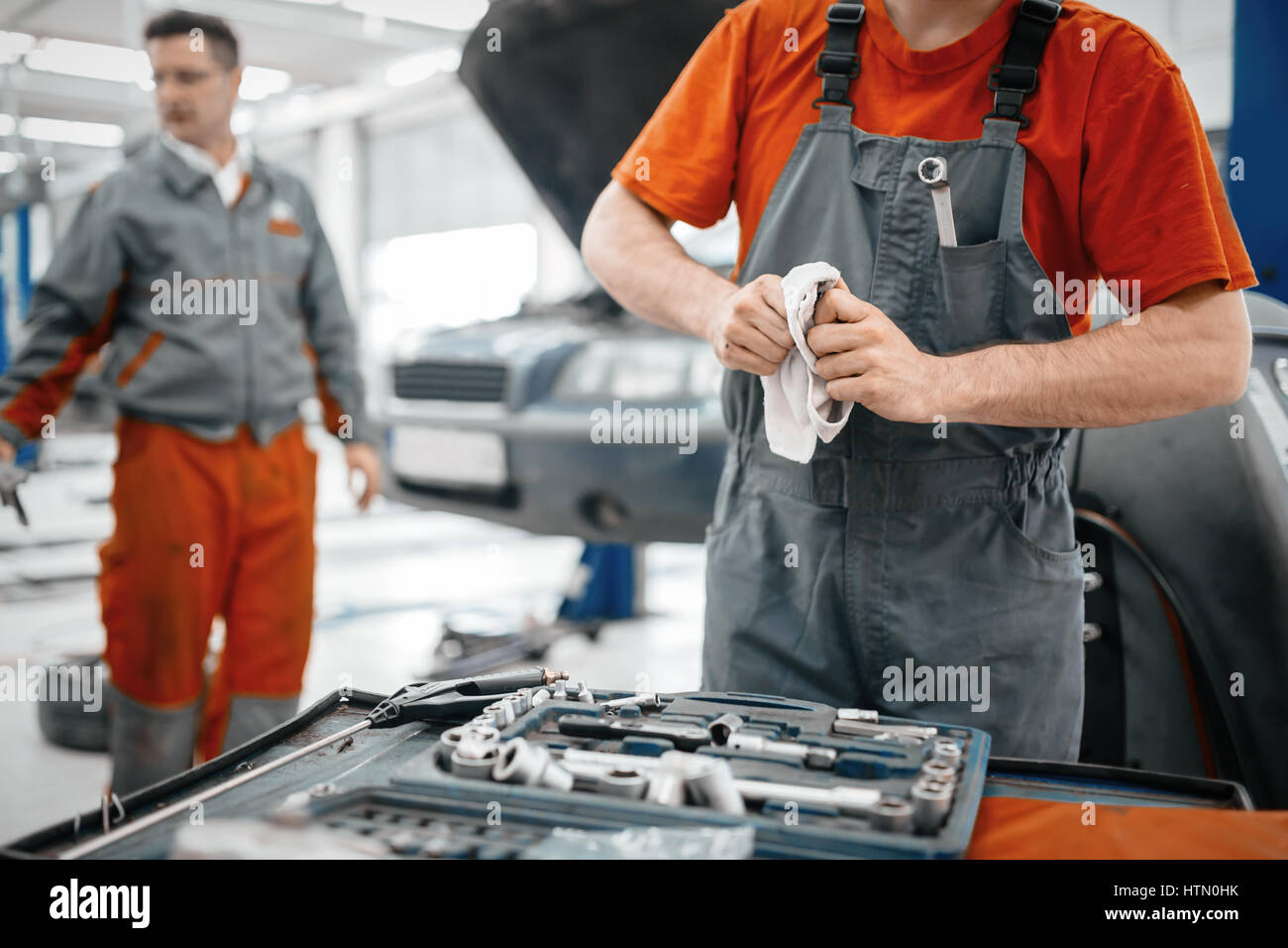 Car mechanic keeping tools polished and clean - Stock Image