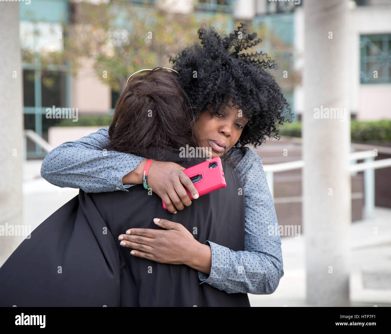 West Palm Beach, Florida, USA. 14th Mar, 2017. Felicia Mitchell, mother of Henry Bennett, III, hugs attorney Jasmine - Stock Image