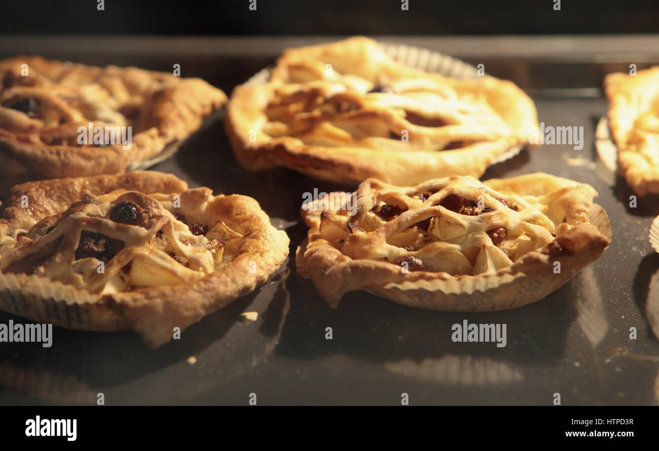 Pies flaky pastry, inside oven, baking tray Baked and rouge - Stock Image
