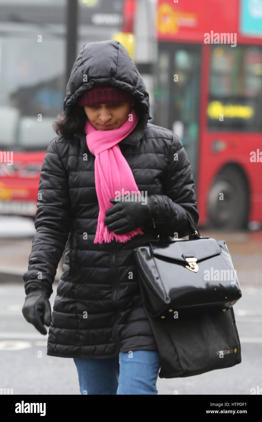 Pedestrians wrap up warm on a freezing winter morning in North London.  Where: London, United Kingdom When: 10 Feb Stock Photo