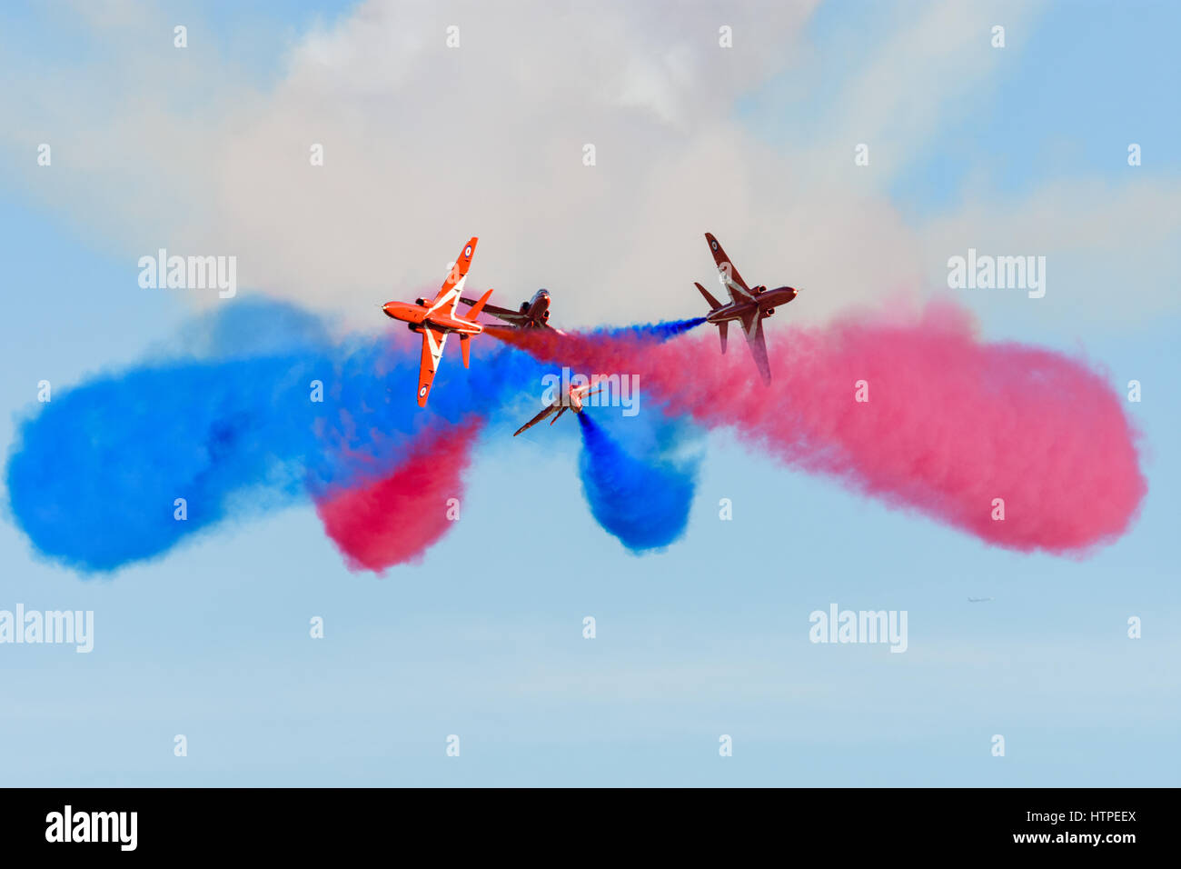Dramatic Red Arrows formation break during an airshow displayStock Photo