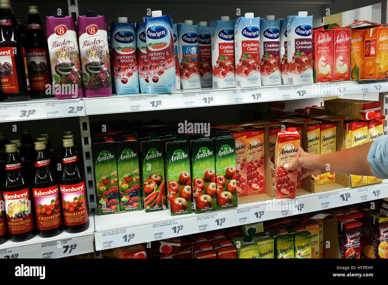 Cartons with diverse brands of fruit juices in a Store - Stock Image