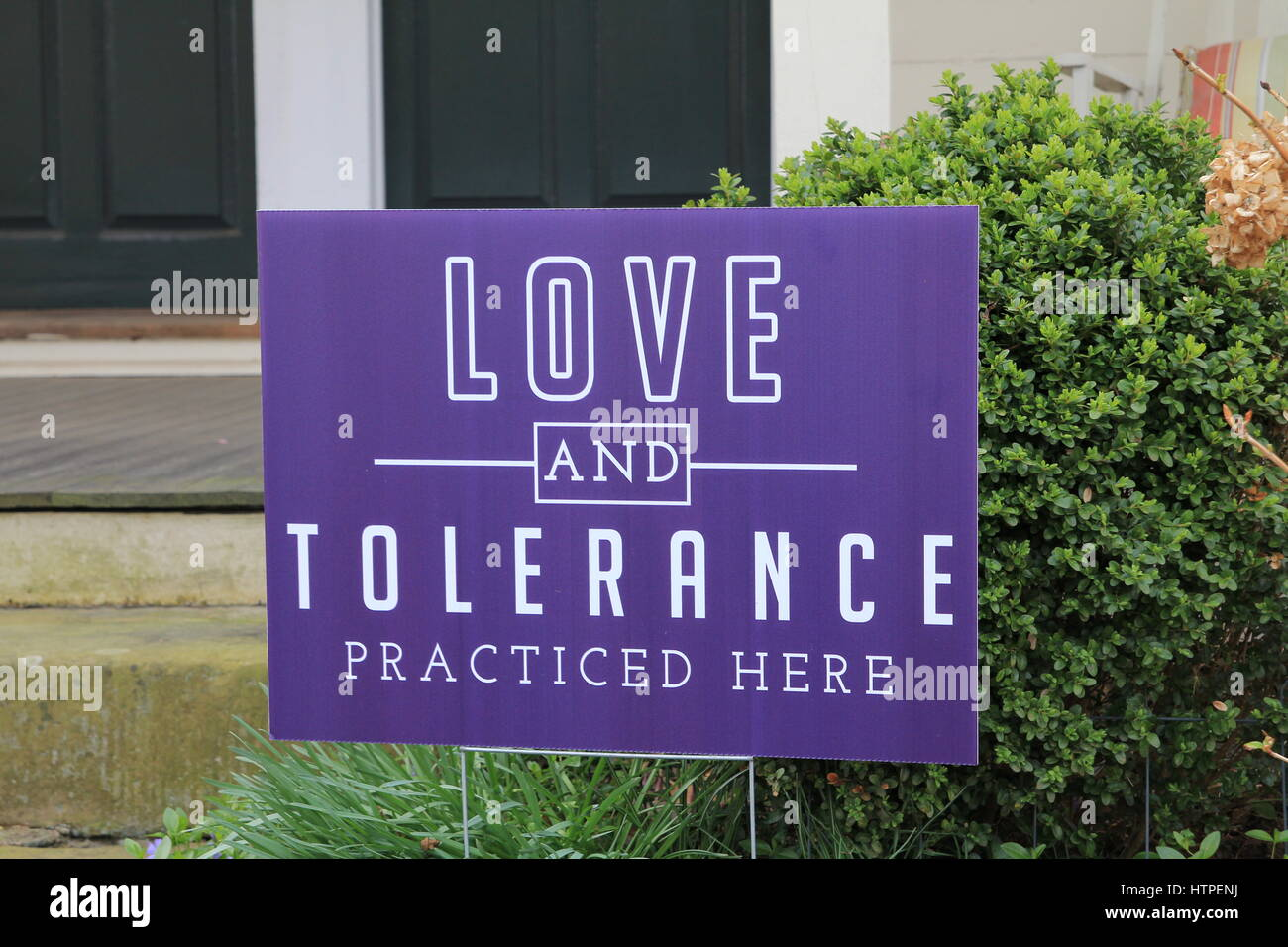 Yard Sign Love and Tolerance Practiced Here - Stock Image