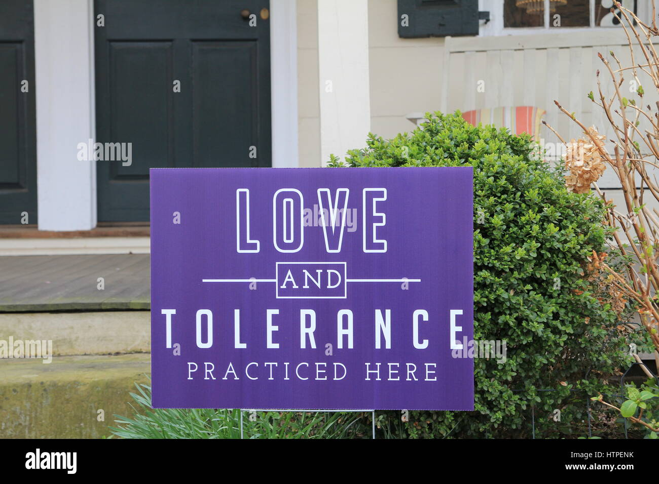 Yard Sign Love and Tolerance Practiced Here Stock Photo