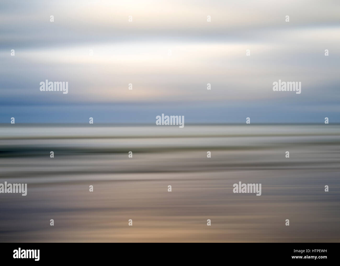 motion blur, de-focused sea, cloudy morning. - Stock Image